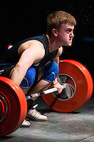 10 MAY 2014 - COVENTRY, GBR - Shaun Clegg from the Olympic Dragons Weightlifting Club prepares to lift during the men's 77kg A category round at the British 2014 Senior Weightlifting Championships and final 2014 Commonwealth Games qualifying event round at the Ricoh Arena in Coventry, Great Britain. Clegg's combined total for the event of 291kg makes him eligible for selection for the England team for the Commonwealth Games in Glasgow (PHOTO COPYRIGHT © 2014 NIGEL FARROW, ALL RIGHTS RESERVED)