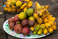 Jatiluwih, Bali, Indonesia.  Mixed Fruits: Mangosteens, Snake Fruit, Bananas, Oranges.