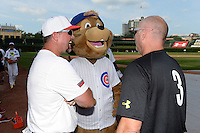 Sean Casey and Billy Ripken (3) joke with the Cubs mascot before the Under Armour All-American Game on August 16, 2014 at Wrigley Field in Chicago, Illinois.  (Mike Janes/Four Seam Images)