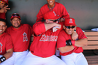 TEMPE - MARCH 10:  Kendry Morales (right) and manager Mike Scioscia of the Los Angeles Angels of Anaheim hang out in the dugout before a spring training game against the Cincinnati Reds on March 10, 2010 at Tempe Diablo Stadium in Tempe, Arizona. (Photo by Brad Mangin)