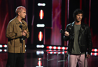 """HOLLYWOOD, CA - MAY 27: Tyler Joseph and Josh Dun of Twenty One Pilots accept Alternative Rock Song & Artist of the Year Award at the 2021 """"iHeartRadio Music Awards"""" airing live from The Dolby Theatre in Los Angeles, Thursday, May 27 (8:00-10:00 PM ET live / PT tape-delayed) on FOX.  (Photo by Frank Micelotta/FOX/PictureGroup)"""