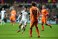 Thursday 28 November  2013  Pictured:Alejandro Pozuelo tries to get a shot past Andres Guardado of Valencia<br /> Re:UEFA Europa League, Swansea City FC vs Valencia CF  at the Liberty Staduim Swansea
