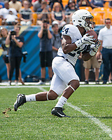 Penn State running back Miles Sanders returns a kickoff. The Pitt Panthers defeated the Penn State Nittany Lions 42-39 at Heinz Field, Pittsburgh, Pennsylvania on September 10, 2016.