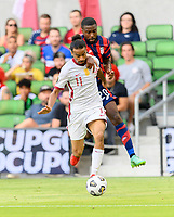 AUSTIN, TX - JULY 29: Shaq Moore #20 of the United States and Akram Afif #11 of Qatar battle for control of the ball during a game between Qatar and USMNT at Q2 Stadium on July 29, 2021 in Austin, Texas.