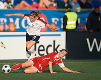 25 May 09:  USA National midfielder Heather O'Reilly #15 jumps over Canadian National midfielder Rhian Wilkinson #7  in an International Friendly soccer game between the US Women's Team and the Canadian Women's Team at BMO Field in Toronto..The US Women's Team won 4-0..
