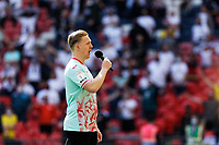 The Welsh national anthem is sung by a male singer during the Sky Bet Championship Play Off Final match between Brentford and Swansea City at Wembley Stadium, London, England, UK. Saturday 29 May 2021