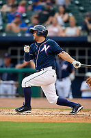 Northwest Arkansas Naturals catcher Luis Villegas (19) follows through on a swing during a game against the Midland RockHounds on May 27, 2017 at Arvest Ballpark in Springdale, Arkansas.  NW Arkansas defeated Midland 3-2.  (Mike Janes/Four Seam Images)