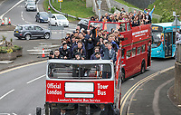 Luton Town players and staff celebrate promotion in front of supporters during an open top bus journey through the streets of Luton displaying the trophy afte gaining promotion to the EFL Championship from League One on 5 May 2019. Photo by David Horn.