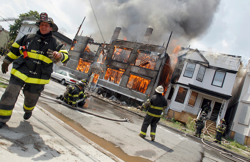 Newark firefighters wait for water as a 5-alarm fire tears through multiple buildings at the  at the intersection of South 20th and Ferdinand Street.  Several Newark firefighters were injured battling the blaze. NEWARK, NJ  (8/11/2010)  ANDREW MILLS/THE STAR-LEDGER..