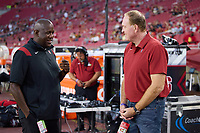 LOS ANGELES, CA - SEPTEMBER 11: Bernard Muir talks on the sideline with Honorary Captain Adam Keefe before a game between University of Southern California and Stanford Football at Los Angeles Memorial Coliseum on September 11, 2021 in Los Angeles, California.