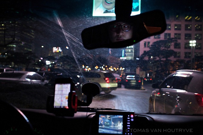 Jae Moo is seen in the rearview mirror of his car in central Seoul, South Korea, on Jan. 3, 2012. Like most South Korean drivers, he uses a GPS and other high-tech gadgets on his dashboard.