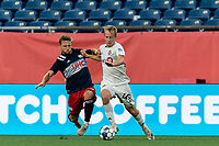 FOXBOROUGH, MA - JULY 23: Pierre Cayet #44 of New England Revolution II and Garrett McLaughlin #49 of Toronto FC II battle for the ball during a game between Toronto FC II and New England Revolution II at Gillette Stadium on July 23, 2021 in Foxborough, Massachusetts.