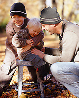 Father and sons enjoy an intimate moment on an autumnal outing