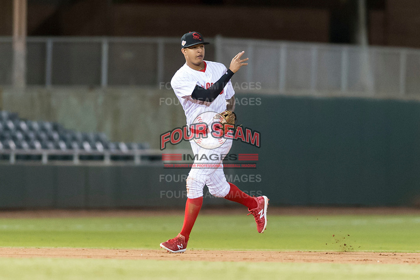 Scottsdale Scorpions shortstop Arquimedes Gamboa (7), of the Philadelphia Phillies organization, throws to second base during an Arizona Fall League game against the Surprise Saguaros at Scottsdale Stadium on October 15, 2018 in Scottsdale, Arizona. Surprise defeated Scottsdale 2-0. (Zachary Lucy/Four Seam Images)