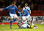 St Johnstone v Dundee....27.11.15  SPFL  McDiarmid Park, Perth<br /> Nicky Low is tackled by Murray Davidson and Chris Millar<br /> Picture by Graeme Hart.<br /> Copyright Perthshire Picture Agency<br /> Tel: 01738 623350  Mobile: 07990 594431