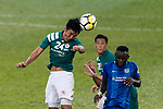 Yingzhi Ju of Long Lions (L) in action against SC Kitchee Forward Alexander Akande (R) during the Community Cup match between Kitchee and Eastern Long Lions at Mong Kok Stadium on September 23, 2017 in Hong Kong, China. Photo by Marcio Rodrigo Machado / Power Sport Images