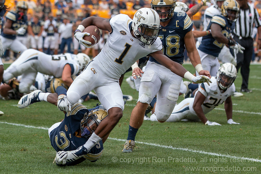Pitt defensive back Damar Hamlin (3) tackles Georgia Tech runner Qua Searcy (1). The Pitt Panthers football team defeated the Georgia Tech Yellow Jackets 24-19 on September 15, 2018 at Heinz Field in Pittsburgh, Pennsylvania.