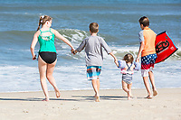 Avon, Outer Banks, North Carolina.  Brothers and Sisters  on the Beach.