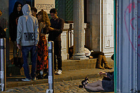Pictured: A woman lays around a pillar in a lane in Swansea. Tuesday 31 December 2019 to Wednesday 01 January 2020<br /> Re: Revellers on a night out for New Year's Eve in Wind Street, Swansea, Wales, UK.