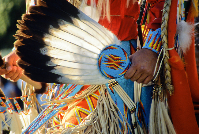 Chippewa-Cree eagle feather dance fan with beaded handle during a pow wow on the Rocky Boy Indian Reservation, Montana