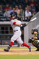 Bryce Brentz (25) of the Pawtucket Red Sox connects on a two-run home run in the top of the 9th inning against the Charlotte Knights at BB&T Ballpark on August 9, 2014 in Charlotte, North Carolina.  The Red Sox defeated the Knights  5-2.  (Brian Westerholt/Four Seam Images)