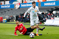 Sunday 18 March 2018<br /> Pictured:  Adnan Maric of Swansea City is tackled by Cameron Boothwich-Jackson of Manchester United<br /> Re: Swansea City v Manchester United U23s in the Premier League 2 at The Liberty Stadium on March 18, 2018 in Swansea, Wales.