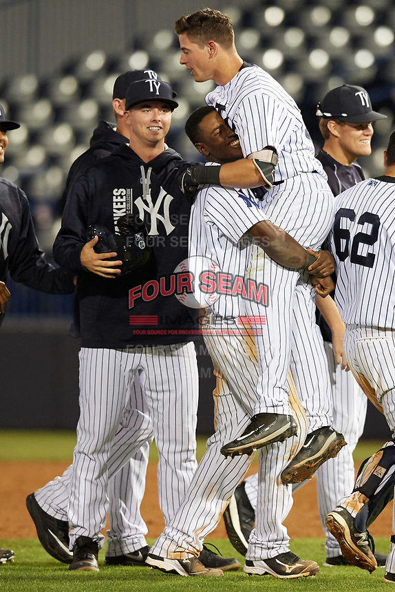 Tampa Yankees second baseman Nick Solak (39) gets picked up by Jorge Mateo (14) as Ian Clarkin looks on after a walk off base hit during a game against the Fort Myers Miracle on April 12, 2017 at George M. Steinbrenner Field in Tampa, Florida.  Tampa defeated Fort Myers 3-2.  (Mike Janes/Four Seam Images)