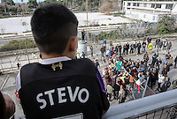 Pictured: A young boy watches on as a scuffle breaks out between migrants and police at the gate of the camp Monday 06 February 2017<br /> Re: Scuffles between migrants and police broke out during a visit by Immigration Policy Minister Yiannis Mouzalas at the Elliniko migrant camp located in the former airport in the outskirts of Athens, Greece.
