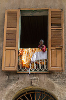 Senegal, Saint Louis.  Boy in Window.