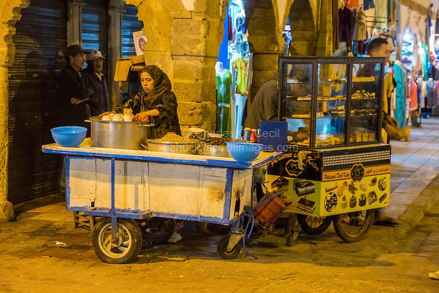 Essaouira, Morocco.  Evening Street Scene, Ave. Mohamed Zerktouni.  Street Corner Snack Vendor.