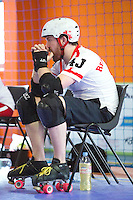 15 MAR 2014 - BIRMINGHAM, GBR - Team England blocker Re-Animated GIF watches play during the inaugural Men's Roller Derby World Cup in the Futsal Arena in Birmingham, West Midlands, Great Britain (PHOTO COPYRIGHT © 2014 NIGEL FARROW, ALL RIGHTS RESERVED)