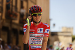 Race leader Red Jersey Rein Taaramäe (EST) Intermarché-Wanty-Gobert Matériaux lines up for the start of Stage 4 of La Vuelta d'Espana 2021, running 163.9km from Burgo de Osma to Molina de Aragon, Spain. 17th August 2021.    <br /> Picture: Luis Angel Gomez/Photogomezsport | Cyclefile<br /> <br /> All photos usage must carry mandatory copyright credit (© Cyclefile | Luis Angel Gomez/Photogomezsport)