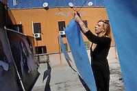 CorpusTRIP ,esposizione in un cortile del quartiere di San Lorenzo a Roma. Lola Kola, artista, è una delle persone ritratte dal fotografo. Lola Kola, artist, is one of the people portrayed by the photographer...CorpusTRIP è un progetto itinerante, esposizione temporanea, in diverse città , evento di una sola notte in uno spazio non specificatamente adibito, occupato o abbandonato. E' il lavoro fotografico di ritratti in bianco e nero ,di  Luca Donnini..CorpusTRIP is a touring exhibition, temporary exhibitions, in different city, an event one night in a space not specifically used, occupied or abandoned. It's the photographic work of black and white portraits of Luca Donnini..