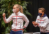 Den Bosch, The Netherlands, April 16, 2021,    Maaspoort, Billy Jean King Cup  Netherlands -  China , seccond day first match: The Dutch players support  Kiki Bertens (NED (L) and Demi Schuurs (NED) support Lesley Pattinama-Kerkhove (NED) on court<br /> Photo: Tennisimages/Henk Koster