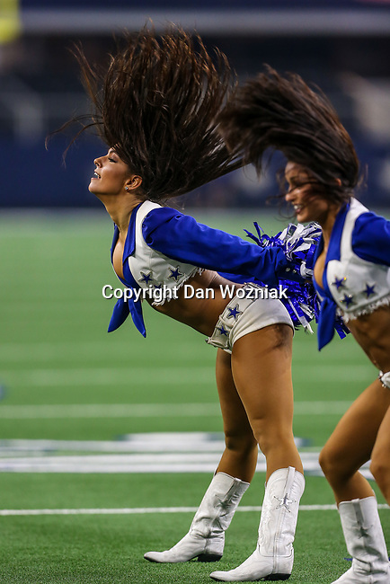 Dallas Cowboys cheerleaders in action during the pre-season game between the Tampa Bay Buccaneers and the Dallas Cowboys at the AT & T Stadium in Arlington, Texas.