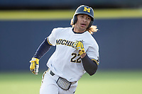 Michigan Wolverines outfielder Jordan Brewer (22) runs to third base against the San Jose State Spartans on March 27, 2019 in Game 2 of the NCAA baseball doubleheader at Ray Fisher Stadium in Ann Arbor, Michigan. Michigan defeated San Jose State 3-0. (Andrew Woolley/Four Seam Images)