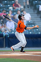 Glynn Davis (10) of the Bowie Baysox follows through on his swing against the Richmond Flying Squirrels at The Diamond on May 23, 2015 in Richmond, Virginia.  The Baysox defeated the Flying Squirrels 3-2.  (Brian Westerholt/Four Seam Images)