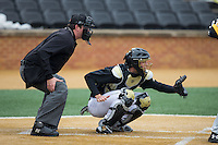 Wake Forest Demon Deacons catcher Nick Bisplinghoff (39) sets a target as home plate umpire Drew Maher looks on during the game against the Towson Tigers at Wake Forest Baseball Park on March 1, 2015 in Winston-Salem, North Carolina.  The Demon Deacons defeated the Tigers 15-8.  (Brian Westerholt/Four Seam Images)