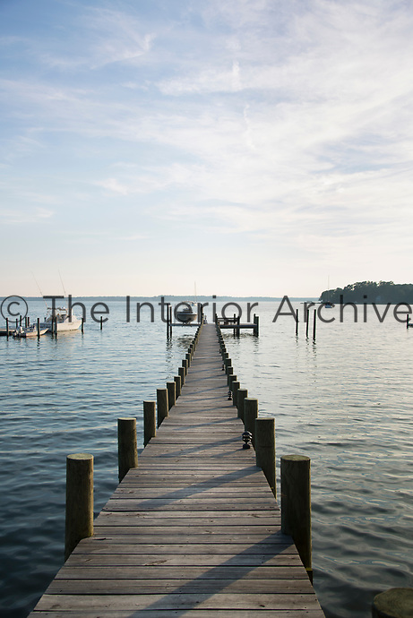 A view along the wooden jetty out towards the lake.
