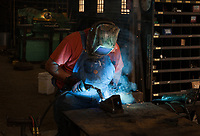 Blacksmith welding and repairing farm equipment, Amira, Eastern Washington State, WA, America, USA.