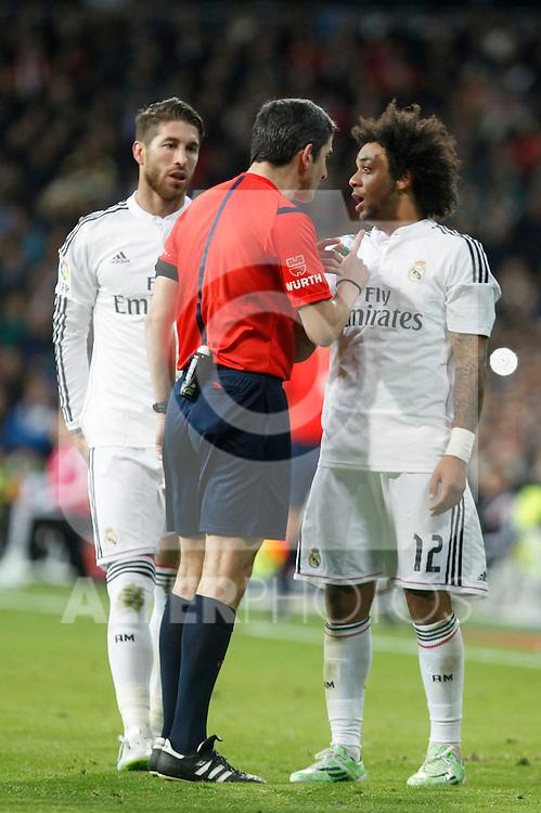 Real Madrid´s Sergio Ramos and Marcelo Vieira argue with the referee during La Liga match between Real Madrid and Celta de Vigo at Santiago Bernabeu stadium in Madrid, Spain. December 06, 2014. (ALTERPHOTOS/Victor Blanco)