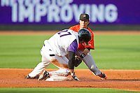 Frederick Keys shortstop Sammy Starr (6) applies a late tag as Yoandy Barroso (27) of the Winston-Salem Dash slides into second base with a double at BB&T Ballpark on May 28, 2013 in Winston-Salem, North Carolina.  The Dash defeated the Keys 17-5 in the first game of a double-header.  (Brian Westerholt/Four Seam Images)