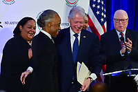 Washington, DC - January 20, 2020:  Former U.S. President Bill Clinton greets Rev. Al Sharpton before he speaks during a breakfast hosted by the National Action Network honoring the legacy of Dr. Martin Luther King, Jr on MLK Day January 20, 2020 at the Mayflower Hotel in Washington, DC.  (Photo by Don Baxter/Media Images International)