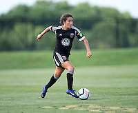 Molly Menchel (14) of the D.C. United Women brings the ball upfield during the game at the Maryland SoccerPlex in Boyds, Maryland.  The D.C. United Women defeated the Charlotte Lady Eagles, 3-0, to win the W-League Eastern Conference Championship.