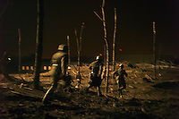 Actors run through a set made to look like a battlefield during the filming of a TV show called in Vlaamse Velden about WWI in Veurne, Belgium on March 22, 2013.