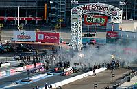 Nov 1, 2020; Las Vegas, Nevada, USA; Overall view as NHRA top fuel driver Antron Brown (left) races alongside Billy Torrence during the NHRA Finals at The Strip at Las Vegas Motor Speedway. Mandatory Credit: Mark J. Rebilas-USA TODAY Sports