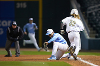 Michael Busch (15) of the North Carolina Tar Heels makes the out at first against Sam Mennitt (30) of the Charlotte 49ers at BB&T BallPark on March 27, 2018 in Charlotte, North Carolina. The Tar Heels defeated the 49ers 14-2. (Brian Westerholt/Four Seam Images)
