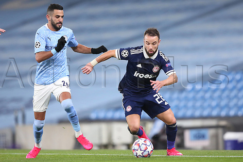 3rd November 2020; City of Manchester Stadium, Manchester, England. UEFA Champions League group stages, Manchester City versus Olympiacos;  Riyad Mahrez Manchester challenges the run from Mathieu Valbuena Olympiakos