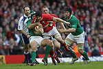 Ireland hooker Rory Best hauls down Wales captain Sam Warburton..RBS 6 Nations.Wales v Ireland.Millennium Stadium.02.02.13.©Steve Pope-SPORTINGWALES