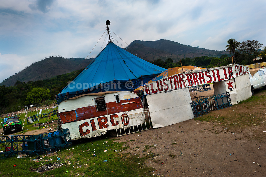 The Circo Brasilia tent pitched on a circus site in a village close to Apopa, El Salvador, 10 May 2011. The Circo Brasilia circus belongs to the old-fashioned traveling circuses with a usual mixture of acrobat, clown and comic acts. Due to the general loss of popularity caused by modern forms of entertainment such as movies, TV shows or internet, these small family enterprises balance on the edge of survival. Circuses were pushed away and now they have to set up their shows in more remote villages. The circus art and culture is slowly dying in Latin America.